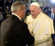 Mr. Wajeeh Nuseibeh, the Custodian for the Key to the Church of the Holy Sepulcher greets Pope Francis in Jerusalem during his latest visit to the Holy Land in May 2014